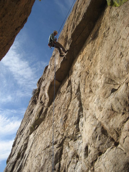 Ben Nadler rappelling. The starting bolts leading up to the roof are visible in the photo.