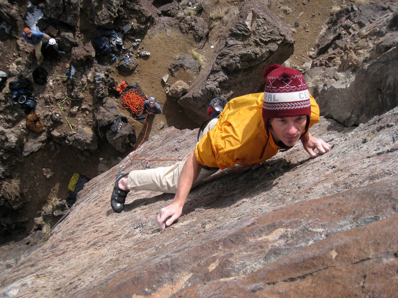 Rock Climbing Photo: Eyeballing the top-out holds while moving through ...
