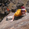 Eyeballing the top-out holds while moving through the steep finishing moves on Cholla Wall. December 2008.