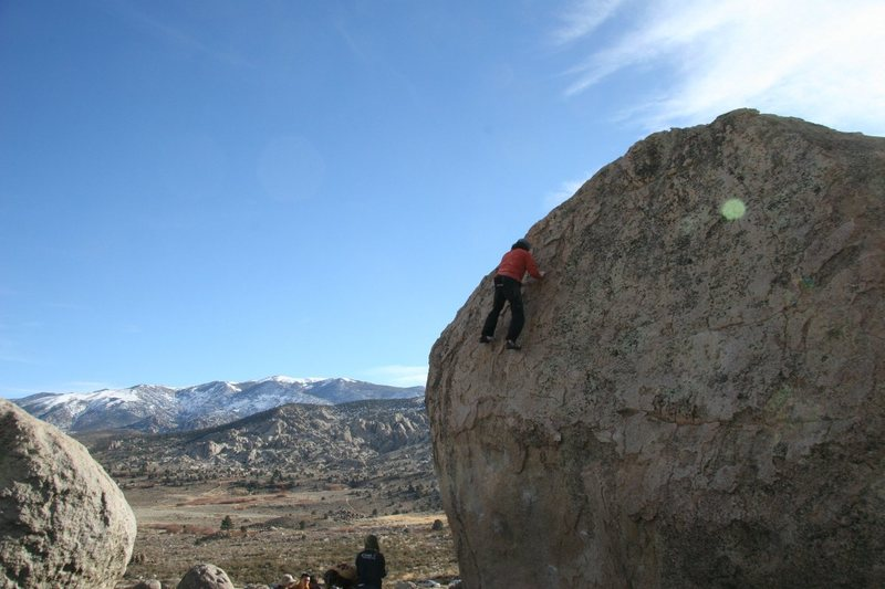 Climbing the easy upper slab of Problem A