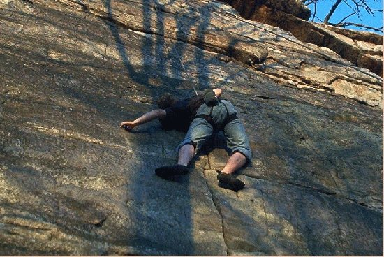 Jeremy Adkins at crux of Team Jesus 5.10a New River WV