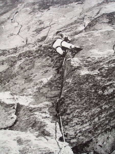 Sticky Fingers 5.10d on the West Face of Chiney Rock. First ascent by Gwain Oka and Hilary Bates summer 1980.  Gwain leading in this pic.
