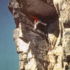 Fun Roof, West Face.  Gwian Oka climbing.  1st ascent done in 1980 by G. Oka, H. Bates and D. Burns