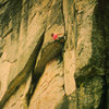 The roof pitch of Illusions/Free Friends, 5.11a, East Face of Chimney rock.  FA Mark Colby and D. Burns 1981