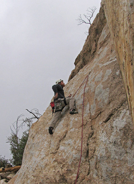 "Yours truly, chalking up (despite the cold) for the slabby crux of ""T and T"" at the Cave Wall."