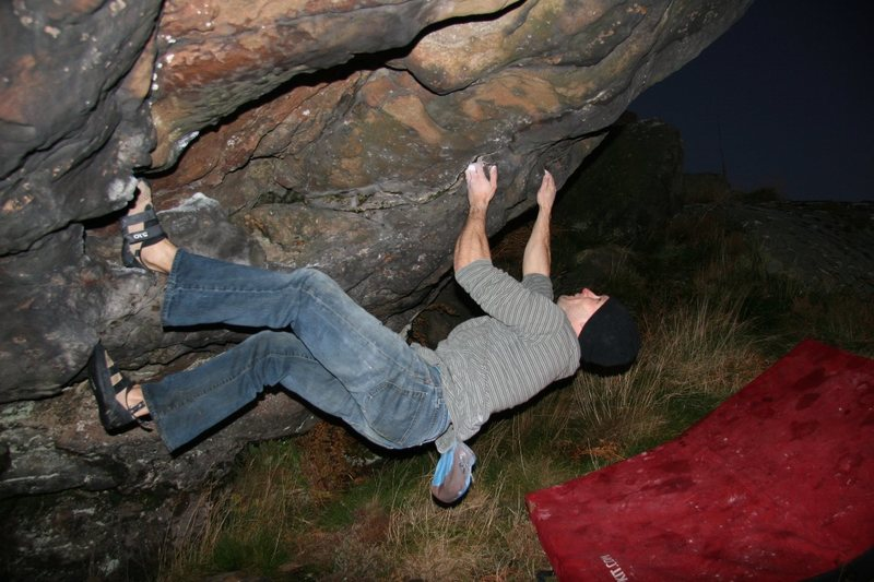 Mike bouldering a V4 in the cave.