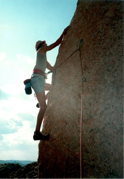 """Me on the FFA of """"Ballbearings Under Foot 5.10a""""."""