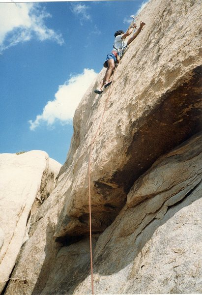 """Rob Mulligan placing the second and last bolt on the FA of """"Hallow Friction 5.10c""""."""
