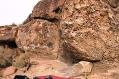 Rock Climbing Photo: The crux prow on The Sixty Foot Woman Traverse, V2