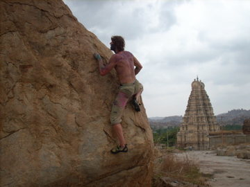 Bouldering over town during Holi Festival, Hampi, India.