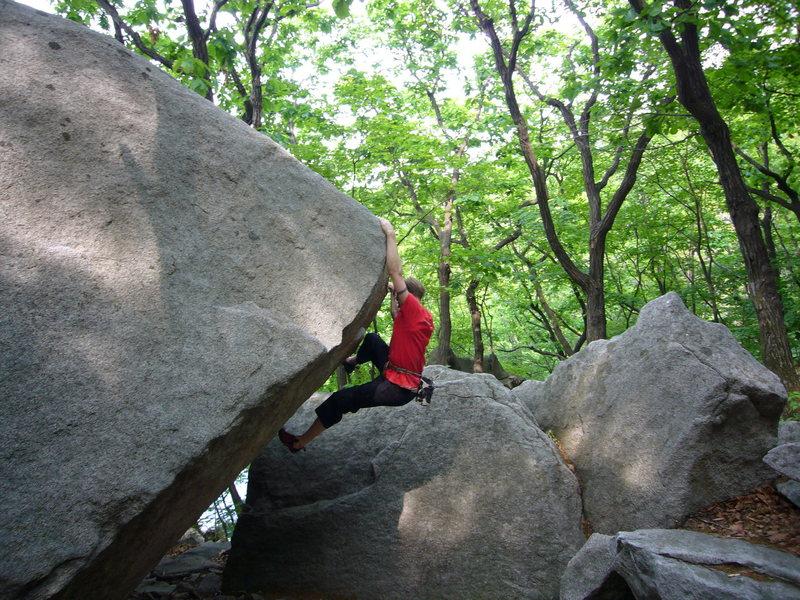 A V5 at the Insubong boulders. Seoul, South Korea