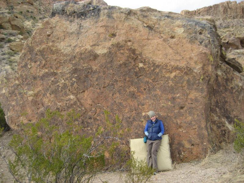 Elizabeth Hobson posing in front of the slab on Jewel Boulder.