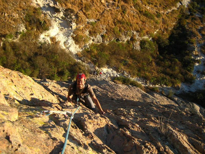 leon islas following one of the first three pitches of 'el lado oscuro de la luna' on pena de bernal.