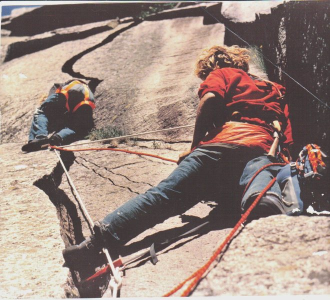 First Ascent:-July/1971.   Starting the Half Moon Crack belayed by John Bragg.