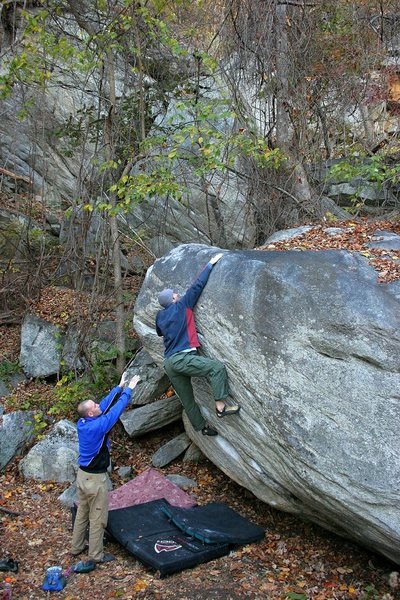 Classic Rumbling Bald sloping topout (V3)