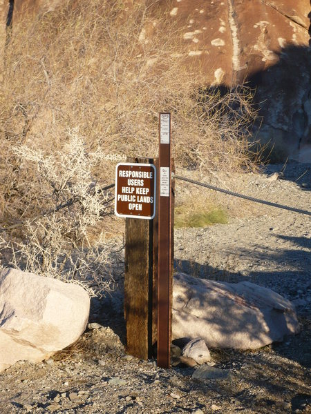 Entrance to Keyhole Canyon with bullet pocks on the slab in the background