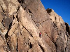 Rock Climbing Photo: Kris Solem stepping up to the bolt. Photo buy Guy ...