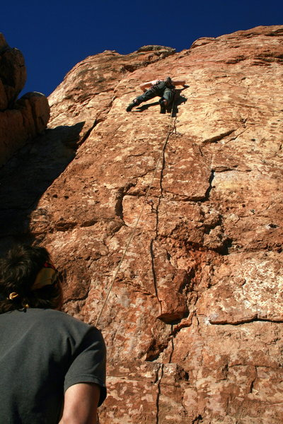 Ian Achey enters the crux.