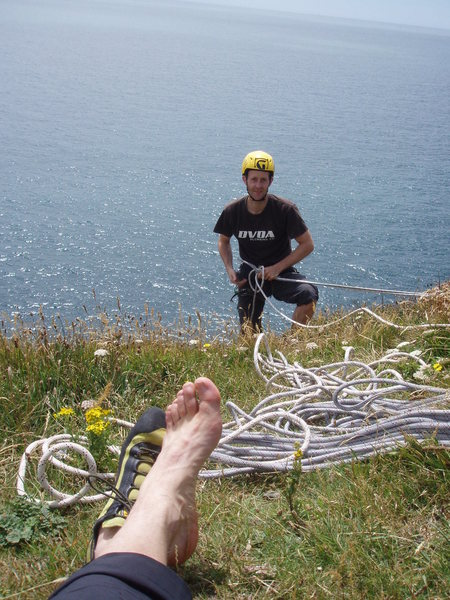 Rapping in to Swanage.  The anchor is two iron pegs pounded an uncertain distance into the turf - scary!  (Forget this guy's name, I climbed with him just for the day.)