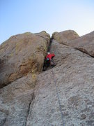 Rock Climbing Photo: Placing the first pro, half-way up the route.