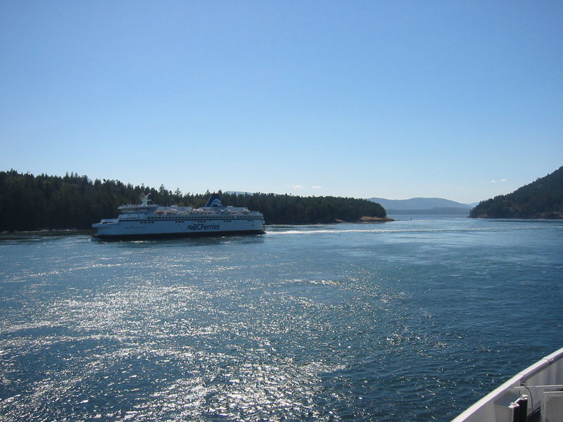 The eastbound ferry (Victoria to Vancouver), taken from the westbound ferry.  They cross in Active Passage, so named because the tidal flow in the passage creates strong currents and whirlpools.