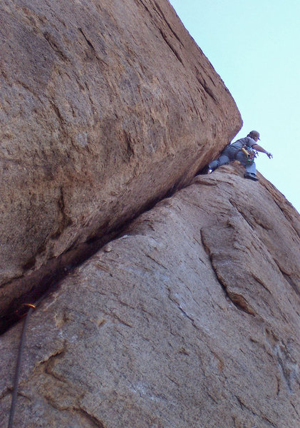 The end of the wide humping.  A few more feet of climbing will put you at the belay hole.  Susan photo.