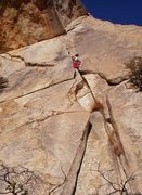 Rock Climbing Photo: Susan eyeing the thinness ahead.
