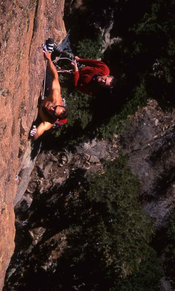 John Kear shirtless on a beautiful December day on the second pitch of Hammerhead. Bryan Pletta on belay.