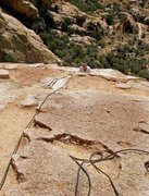 Rock Climbing Photo: Susan topping out on the slab just before the big ...