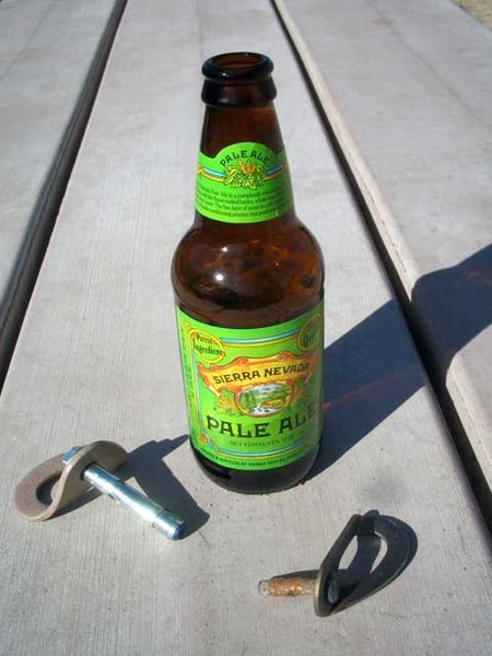 "Ryan Mattock and I did the duty and replaced the mank bolt on 01-06-09. It came out with no effort. Ryan re-drilled the same hole and placed a 3/8"" 5 piece Rawl. Nice work.<br> <br> For comparison, the old bolt and one like it's new replacement...  The Ale bottle is for scale...  you know, Ale for scale? Right?"
