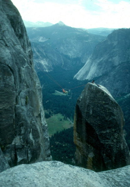 Lost Arrow Spire Tyrolean Traverse, Yosemite.<br> Glacier Point is near foreground; Starr King in distance.