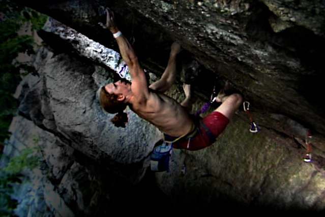 Kansas City, Near Traps.  The greatest 5.12 move in town.  Climbing barefoot.  I make the crux toss for a send.