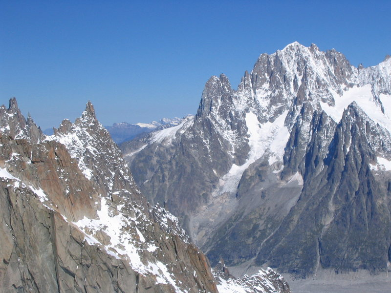 The Aiguille du Grepon (pointy spire 2nd from left), the Dru (twin-summitted spire at center), and Aiguille Verte (pyramid summit on the right) rising above the Mer de Glace.  The classic Bonatti Pillar climbs the left skyline of the Dru.