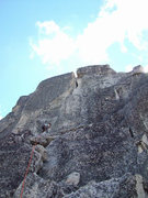 Rock Climbing Photo: The upper pitch of the route traverses out right a...