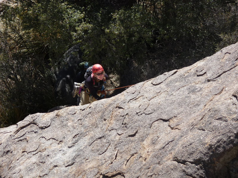 Sarah around the top of the run-out section on the route <em>Winter Solstice</em> (5.6R), <em>Winter Solstice Slab</em>.  None of the rock of the actual route is shown.  Photo is taken via zoom from the top of <em>Upper Dome</em>.
