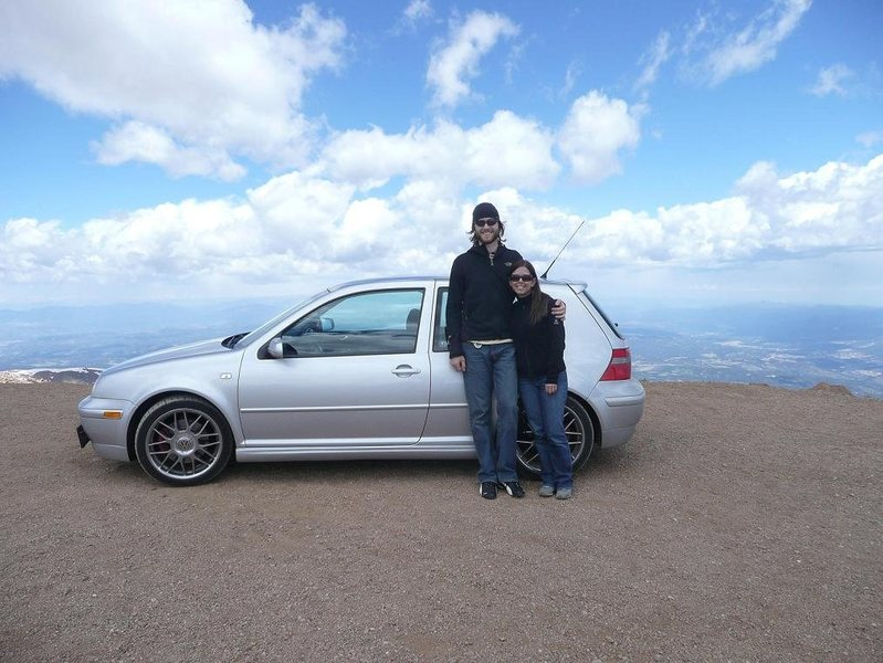 Lynn and me with the GTI after flying up the twisties at Pike's Peak.