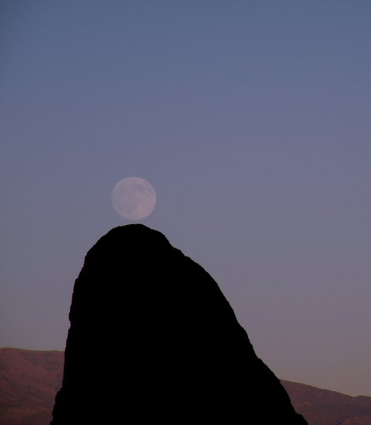 Moon and boulder in the Buttermilks