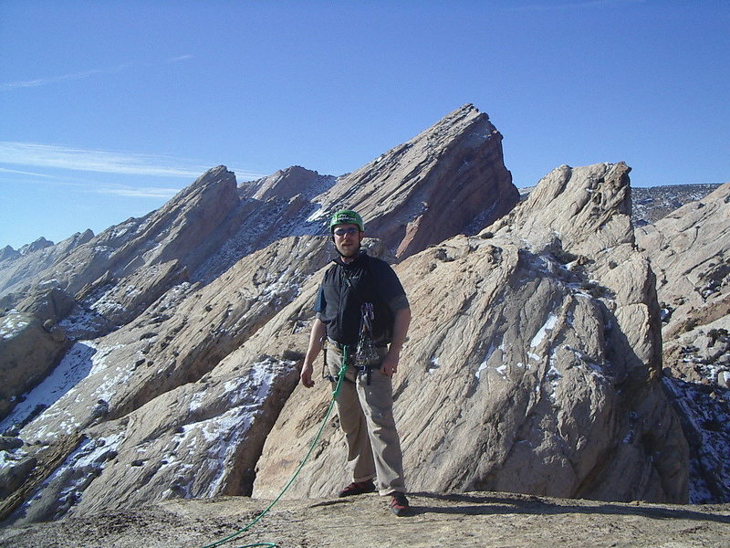 Views from the summit. Behind Pat the ridge of the  North Peak