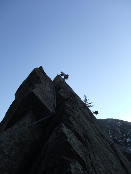 Barry making the traverse from the summit to the Dirty Deed's rappel start.