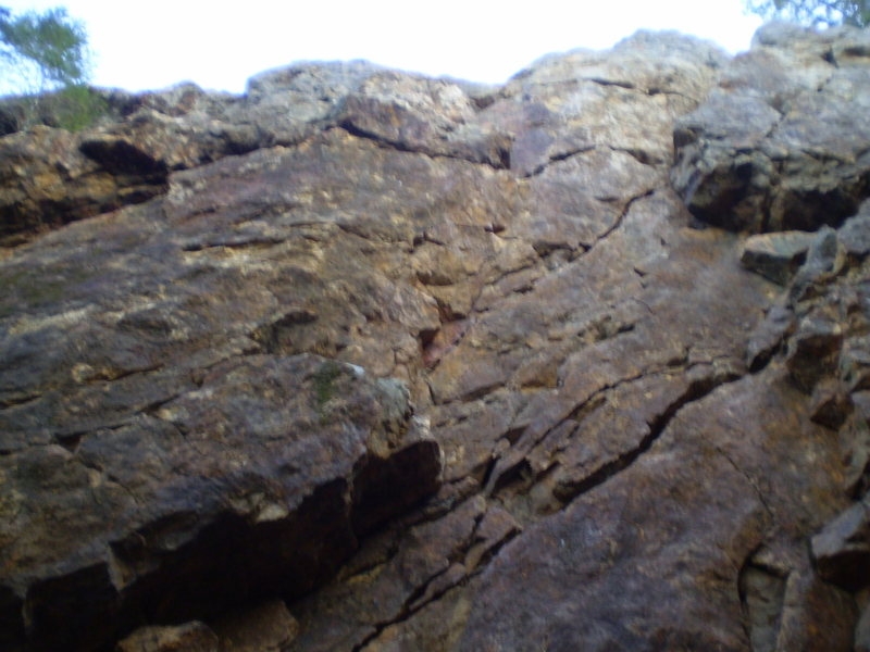 Fuzzy photo of the wall.  Distinguishing features are the rt. and lt. corners facing each other.  There used to be an arch here (?) as noted in route descriptions