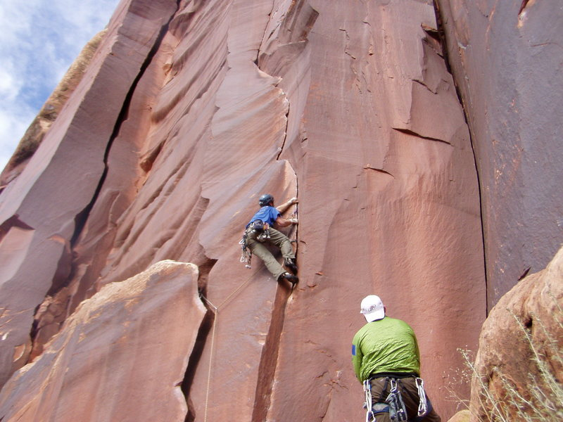 I just traversed from the wide crack to the thin crack (crux).    The piece to my left is a very tipped out old #5 camalot.  A #6 would have been much better.  Also, you can climb straight up to this spot @ 12-.