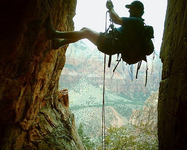 Rappelling short 5th class chimney on long hiking route to Hidden Arch (above Watchman campground.)