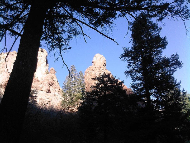 This one is taken from a little past the Grad Boulder as heading up canyon.  The route GI Joe starts from the base of the big pine trees left of the spire.