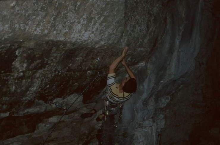 A crux move on Reanimator.  The wall is very steep and you have to roll up on a very shallow pocket.