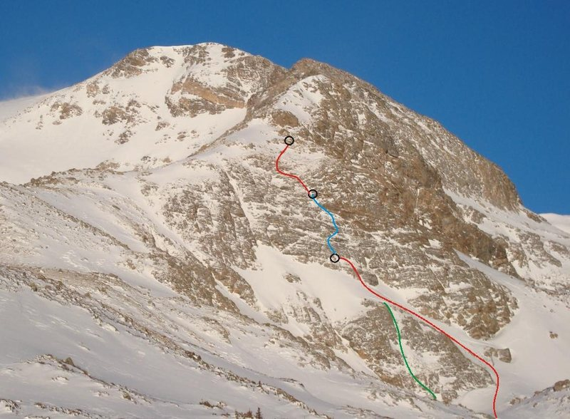 The green line shows a direct start, but to me it seemed rather short and not worth bothering with ropes etc. especially since there's such a nice snow climb up around it.<br> <br> We climbed the snow (1st red line) to the base of the wall, then our P1 (blue line), the P2 (2nd red line).<br> <br> P1 was a full 60m.<br> P2 was ~45m.<br> <br> Many variations exist.