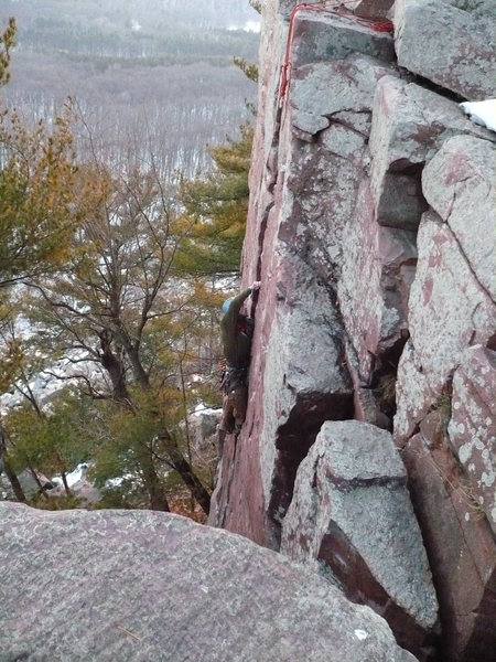 John K. placing gear high up Birch Tree Crack.<br> <br> Photo by Mike O.