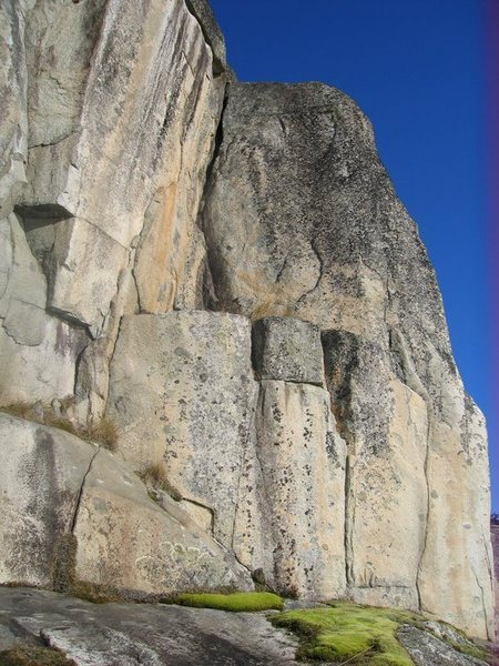 Gain the ledge (5.9 or 10b layback) and head up hand crack in open book.