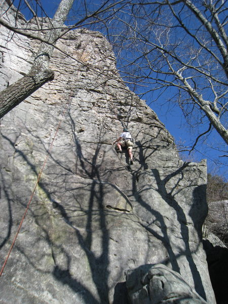 Josh Bivins heading up Knob Wall on top rope.  Good horns all the way to the top hence the name.  Great warm up with good sun!
