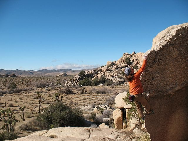 Enjoying the finish of Native Arete (V0), Joshua Tree NP