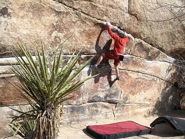 Working up towards the vertical crack of High Noon (V5), Joshua Tree NP